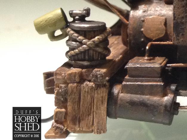 Close up of the roped keg and mug.